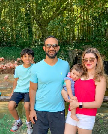 family picture of the blogger in the zoo with flamingos in the back