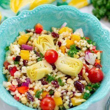 Pearl Couscous Mediterranean salad in blue bowl