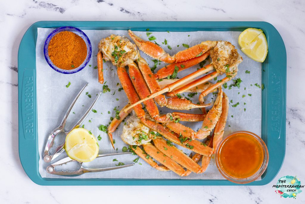 snow crab with spice garlic butter on a tray