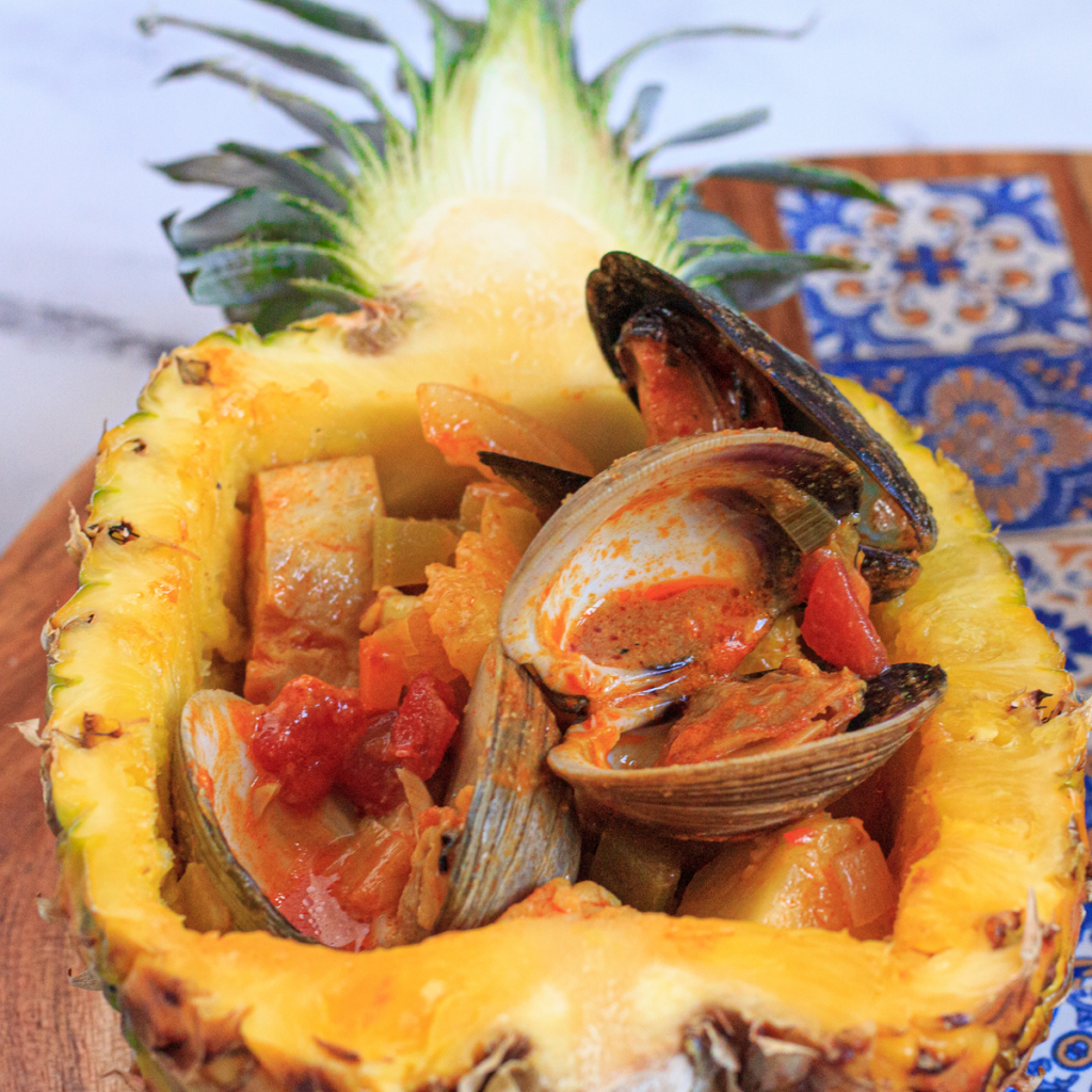 pinapple bowl filled with seafood