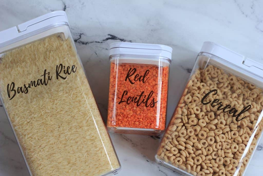 pantry containers filled with cereal, red lentil and rice