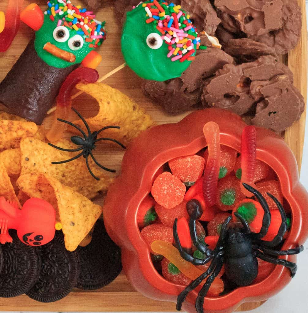 dummies and candies with a plastic spider on it