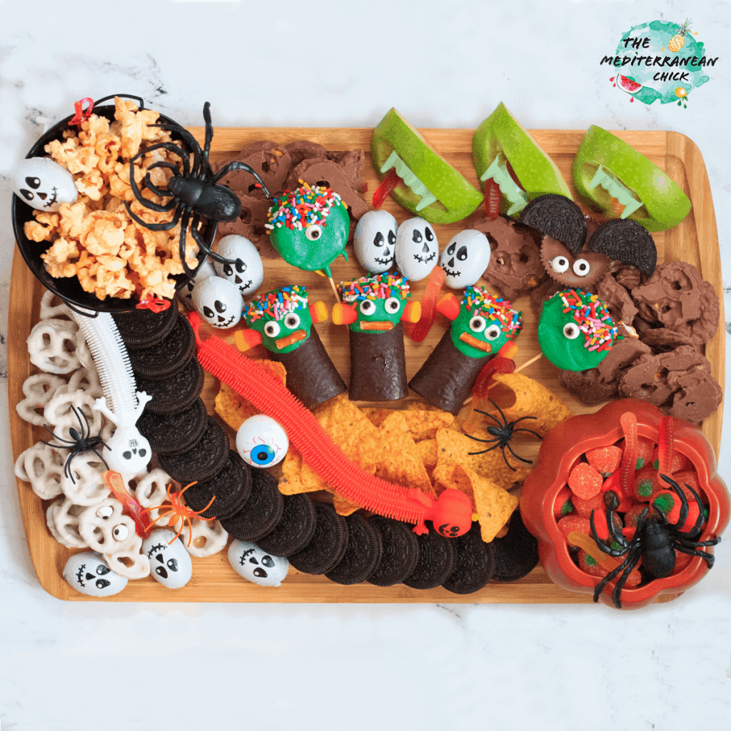 Halloween Platter for kids full of candies, fruits and chips