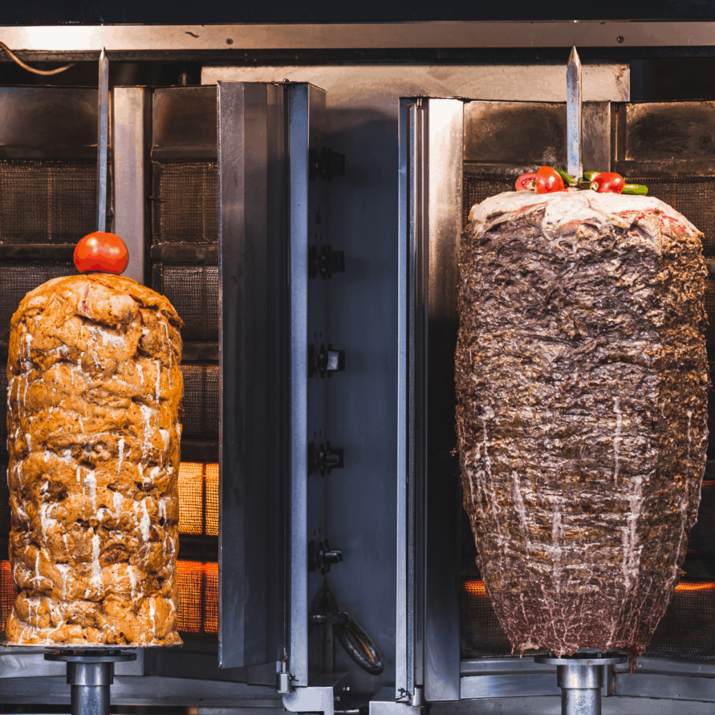 two beef and chicken tall rotating shawarma skewer